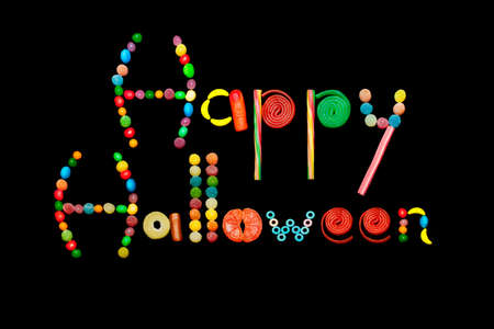Text with multicolor candies on black background