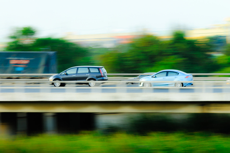 Cars on highway motion blured photo