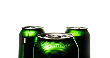 Three green cans of beer. Background for a pub. Beer store. Relax at the weekend. Summer with beer. Low alcohol percentage. Packaging and ecology. White background.