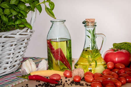 Bottles with flavored oil. Tastes of Italy. Basil, pepper and garlic. Preparing a salad.. Tomatoes and flavors of pizza. Standard-Bild