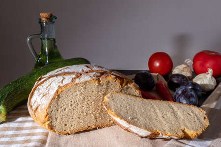 Polish bread on a country table. Plum taste of summer. A home-made breakfast. Europe, Poland, Mazovia.