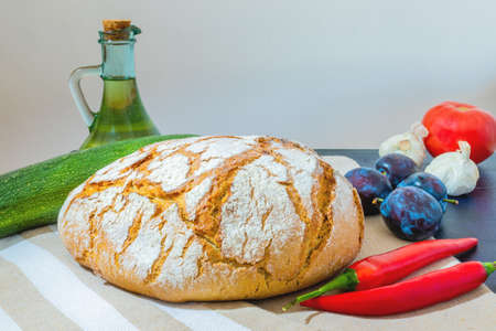 Polish bread on a country table. Plum taste of summer. Europe, Poland, Mazovia.