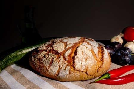 Polish bread on a country table. Plum taste of summer. Europe, Poland, Mazovia.