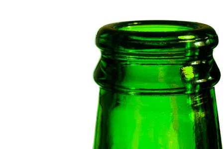 A green beer bottle. Bottleneck in green over a white background.