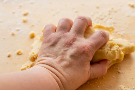 Hand kneading dough. Homemade sweet cake. Family pastries. Tart weekend. Pastries for Christmas. Man and home. Stock Photo