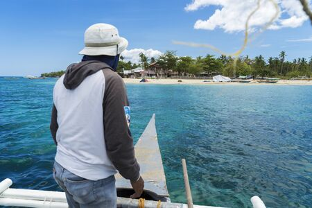 boatman: Arrival to tropical island by boat with boatman Stock Photo
