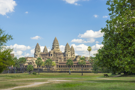 Ancient temple Angkor wat on a sunny day with horse, blue skay and many clouds in Siem Reap. Cambodia Stock Photo