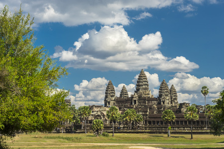 Ancient temple Angkor wat on a sunny day with horse, blue skay and many clouds in Siem Reap. Cambodia Zdjęcie Seryjne