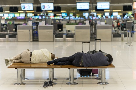 Bangkok, Thailand - march 1, 2016: People sleeping in night airport terminal Suvarnabhumi  while waiting fly