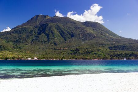 Beautiful tropical Island with white sand and volcano in the background. Camiguin. Philippines