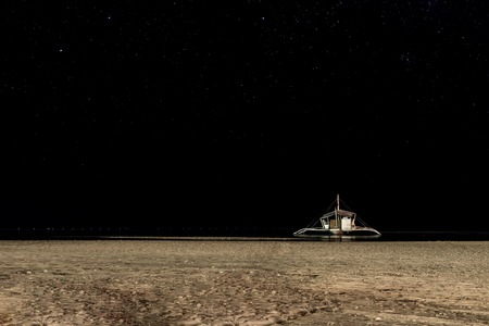philippine: Philippine boat on the shore at night time under starry sky