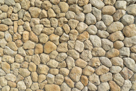 lite: yelow and lite oval stones in the wall like background