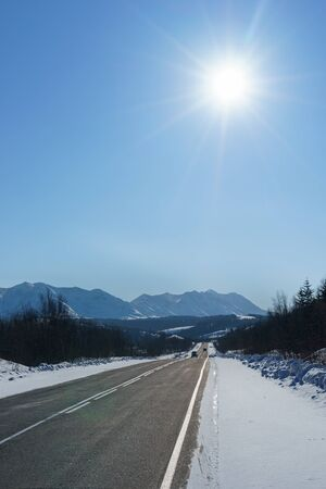 ander: Highway to the mountain among snow and ice at winter time ander blue sky