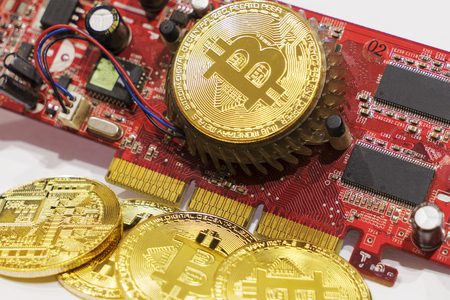 some of crypto currency symbol bitcoin on red video card Stock Photo