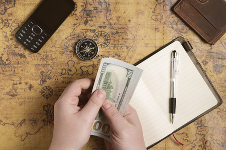 Man is planing his trip and prepearing equipment, money, route and documents Stock Photo