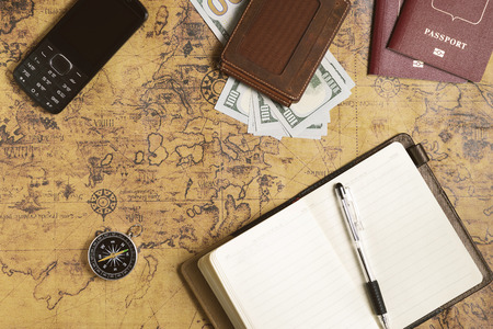 equipment, notebook and money for adventures on the ancient map