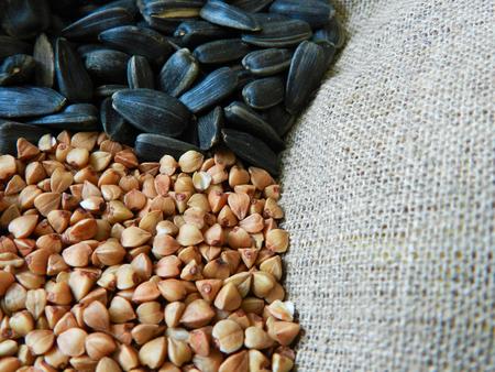 sac: Buckwheat and sunflower seeds on the sac close up photo