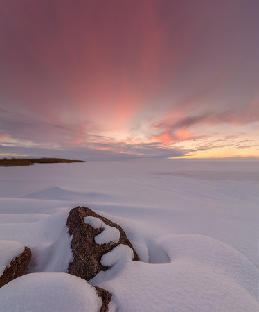 snow tree: Winter sunset with snow-covered rocks. Composition of nature. Stock Photo