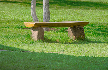 front yard: Stone bench on the front yard lawn. Landscape design. Stock Photo