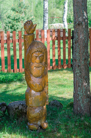 Statue made of pine. Wooden man. Option of your garden decor