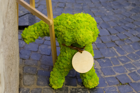 Dog peeing. Decorative figure of moss. Moskow Stock Photo