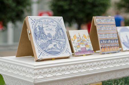 stoneware: Tiles at the fair in Russia. Patterns handmade Stock Photo