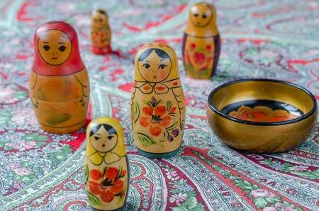 nesting: Russian nesting dolls on the traditional handkerchief. Vintage Stock Photo