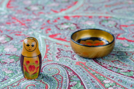 Russian nesting dolls on the traditional handkerchief. Vintage Stock Photo