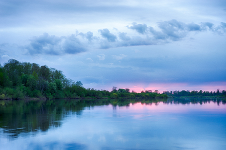 Colorful sunset in the river with reflex