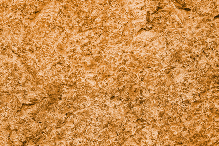 Dark cheddar color wall texture abstract background.