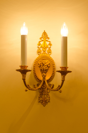 Wall light of gilded metal with two electric candles