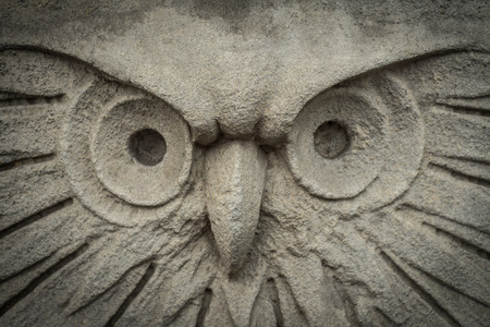 Gray plaster in the form of an owl. Close up Standard-Bild