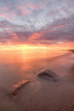 Majestic summer sunset over the Chudskoy lake. Estonia.