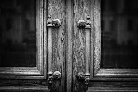 Old Antique Handles On Wooden Entrance Door. Handles On Wooden Door. Black And White Background