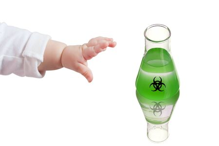 Child pulls his hand to a dangerous substance. Child hand. Flask biohazard green poison. Danger warning. Poison, danger symbol. Chemical experiment.