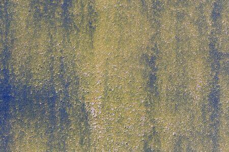 Rusty yellow metallic frame texture background. Close up