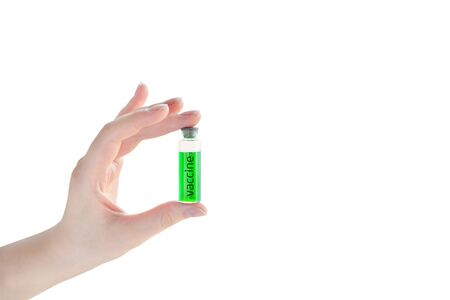 Ampoule with vaccine from a new coronavirus in a woman hand isolated on white background. Flu vaccination concept.