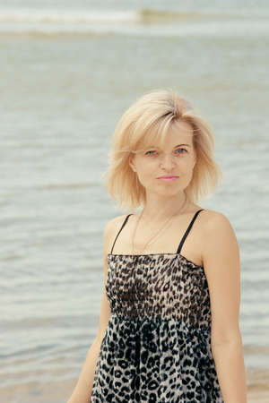 Beautiful  woman posing at the beach Stock Photo - 11277207