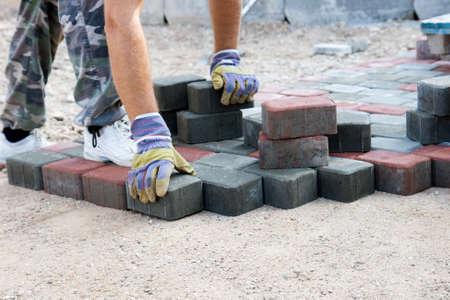 brick paver working on new street Stockfoto