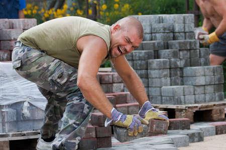 pave: Paver on job. Constructing a new street
