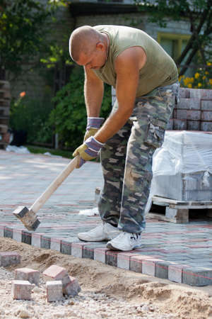 Paver on job. Constructing a new street photo