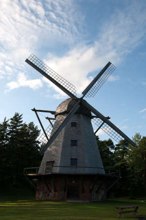 traditional windmill: An old traditional windmill with wooden sails in countryside Stock Photo