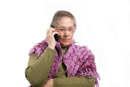 old woman talking on the phone on white background Stock Photo