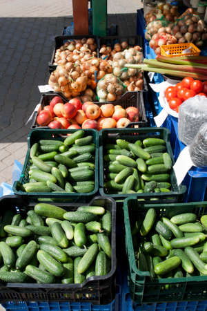 Fresh vegetables and fruits at a farmers market photo