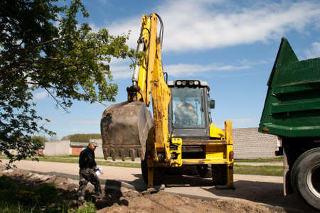 new street construction with excavator, dump truck and works manager Stock Photo - 12395167