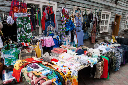 used clothes: Market Bargains .Clothing at an outdoor flea market street stall Editorial