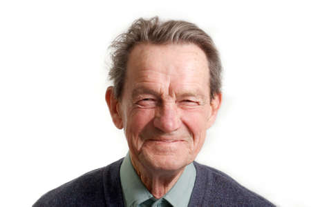 aging face: face portrait of a cheerful smiling senior man