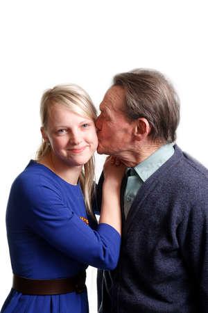 grandfather kissing granddaughter on white background photo