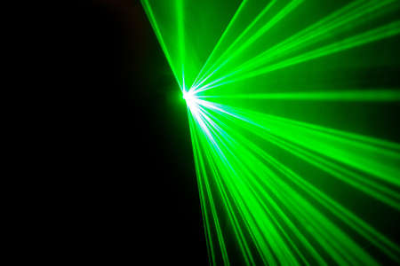 Real green laser lights on black background