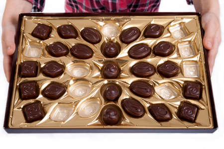 boxed: half empty box of chocolates in little girl hands